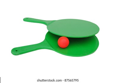 Two green rackets with a ball isolated on white background