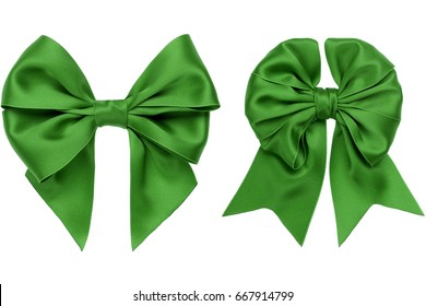 Two green satin bow with tails on white background