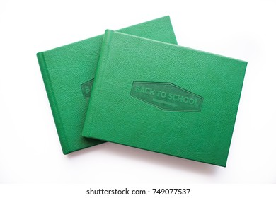 Two green school photoalbum on white background