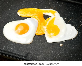Two grilled heart shape eggs