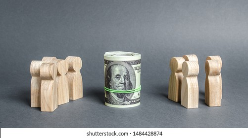 Two groups of people are divided by a bundle roll dollars. Investment concept. High profits and a welcome item. The cult of money, capitalism. Financial instruments and education. Decent salary wages