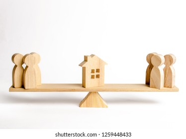 Two groups of people on the scales are suing the house. Conflict of interests and claims regarding the ownership of house. Illegal seizure of property, the return of the acquired house fraudulently