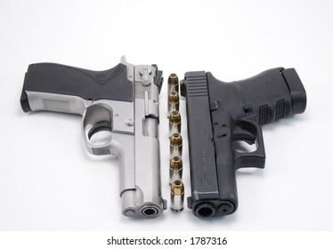 Two guns on white background 9 mm gun and glock 45 with bullets