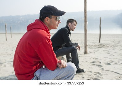 Two guy sitting on the bank on the Danube river