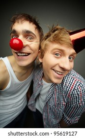 Two guys having fun making faces at camera on fool�s day