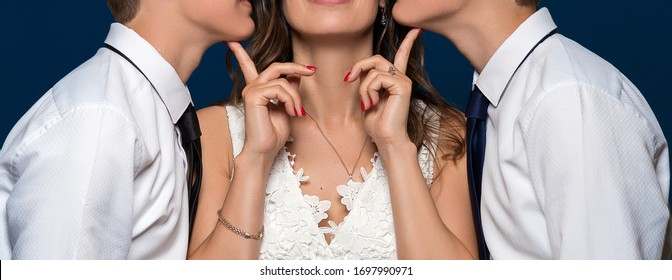 two guys kiss one girl in a white dress on a blue background