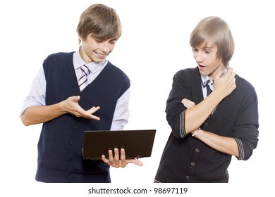 Two guys look the computer