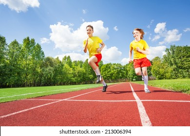 Two guys running together in competition