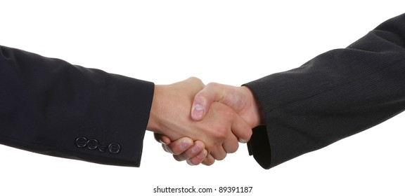 two guys shaking hands wearing suits