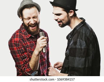 Two guys singing over white background