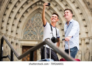 two guys walking the city and doing selfie