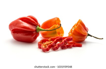 Two Habanero chili red and orange with chopped slices isolated on white background hot Chinese pepper one halved
