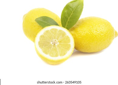 Two and a half lemons on white background