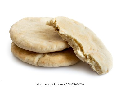 Two and half plain pita breads isolated on white from above.
