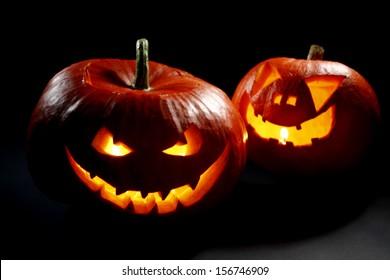 Two halloween pumpkins on black background
