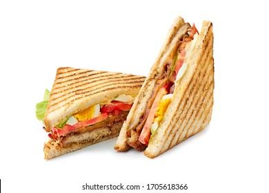 Two halves of fresh club sandwich on white