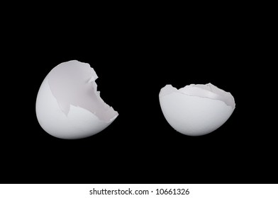 Two halves of a white cracked egg isolated on black background.
