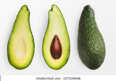 Two halves and whole avocado isolated on white background., top view