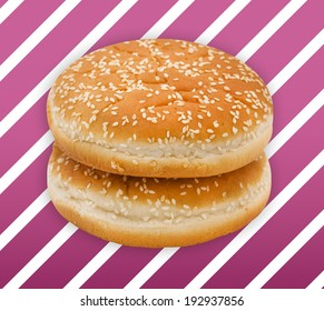 Two hamburger bun with sesame seeds on pink  background with white stripes.