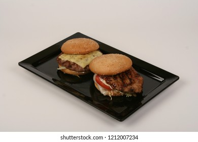 two hamburgers on black dish