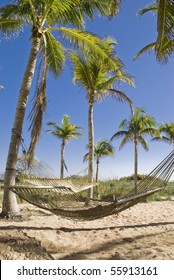 Two hammocks gently swaying in the cool Caribbean sea breeze.