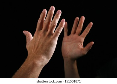 Two hand giving a high five as a for of greeting.