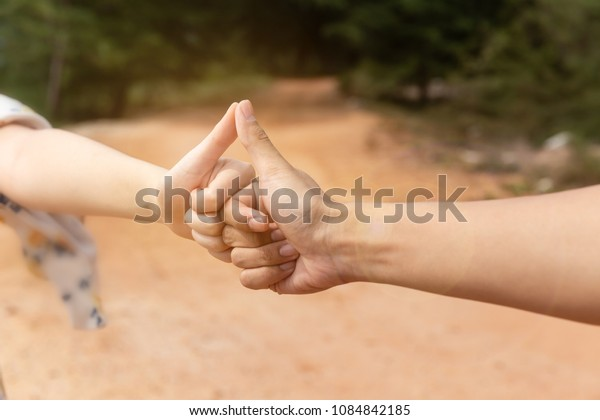 Two hand hit together and show thumb up.