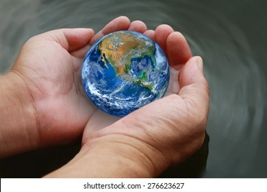 two hand hold the earth on water ,water in the palms of man, safe the world and environment background, climate change and global warming, including elements furnished by NASA