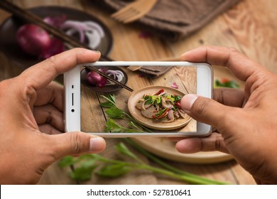 Two hand take the food photo with smartphone