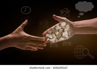 Two hand touch and will shake together on black background with stone and soil in hands-bribery,corruption and venality concepts