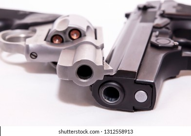 Two handguns, a 40 caliber pistol and a 357 magnum revolver on a white background