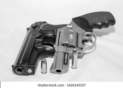 Two handguns, a 40 caliber pistol and a 357 magnum revolver along with a bullet for each shot in black and white