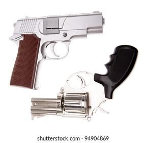 Two handguns on plain background