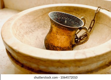 A two- handled Natla cup for hand washing in Judaism.