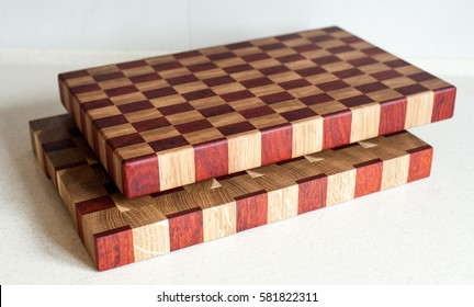 Two handmade end grain cutting boards. Parallel view