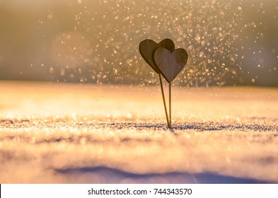 Two handmade hearts and snow nature. Valentine background photo