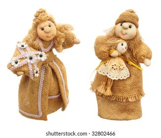 Two handmade sackcloth dolls isolated on white background. Parana city, province of Entre Rios, Argentina