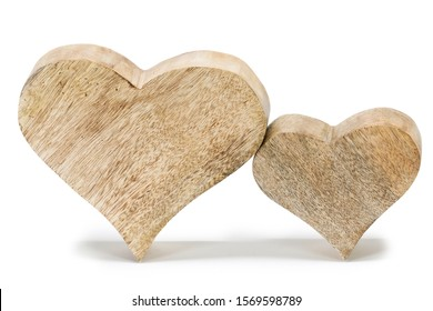 Two handmade wooden carved hearts isolated on white background couple relationship Valentine day concept