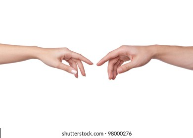 two hands apart, reaching touching each other. man and woman