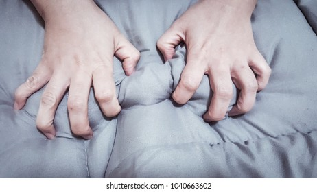 Two hands, Asian girl, pecking sheets, because of orgasm, from hot sex With the concept of abstract.