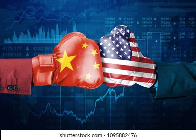 Two hands of business people wearing boxing gloves with China and USA flag. Shot with trade stock background