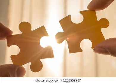 two hands of businessman connect puzzle piece. sign, symbol, concept of connecting