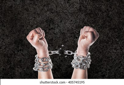 Two hands in chains on a grunge background with scratches