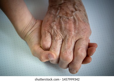 two hands: child and elderly person