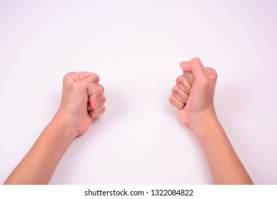Two hands in closed fist, isolated against white background.