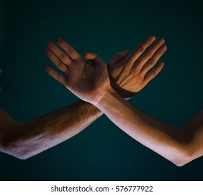 Two hands in contact.