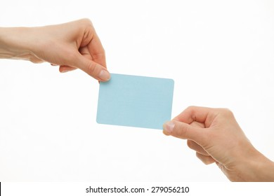 Two hands demonstrate a blue paper card, white background