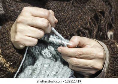 Two hands doing a knitting stitch / Knitting Hour