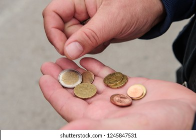 Two hands with European coins. Concept of counting and saving money.