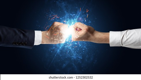 Two hands fighting with light, glow, spark and smoke concept